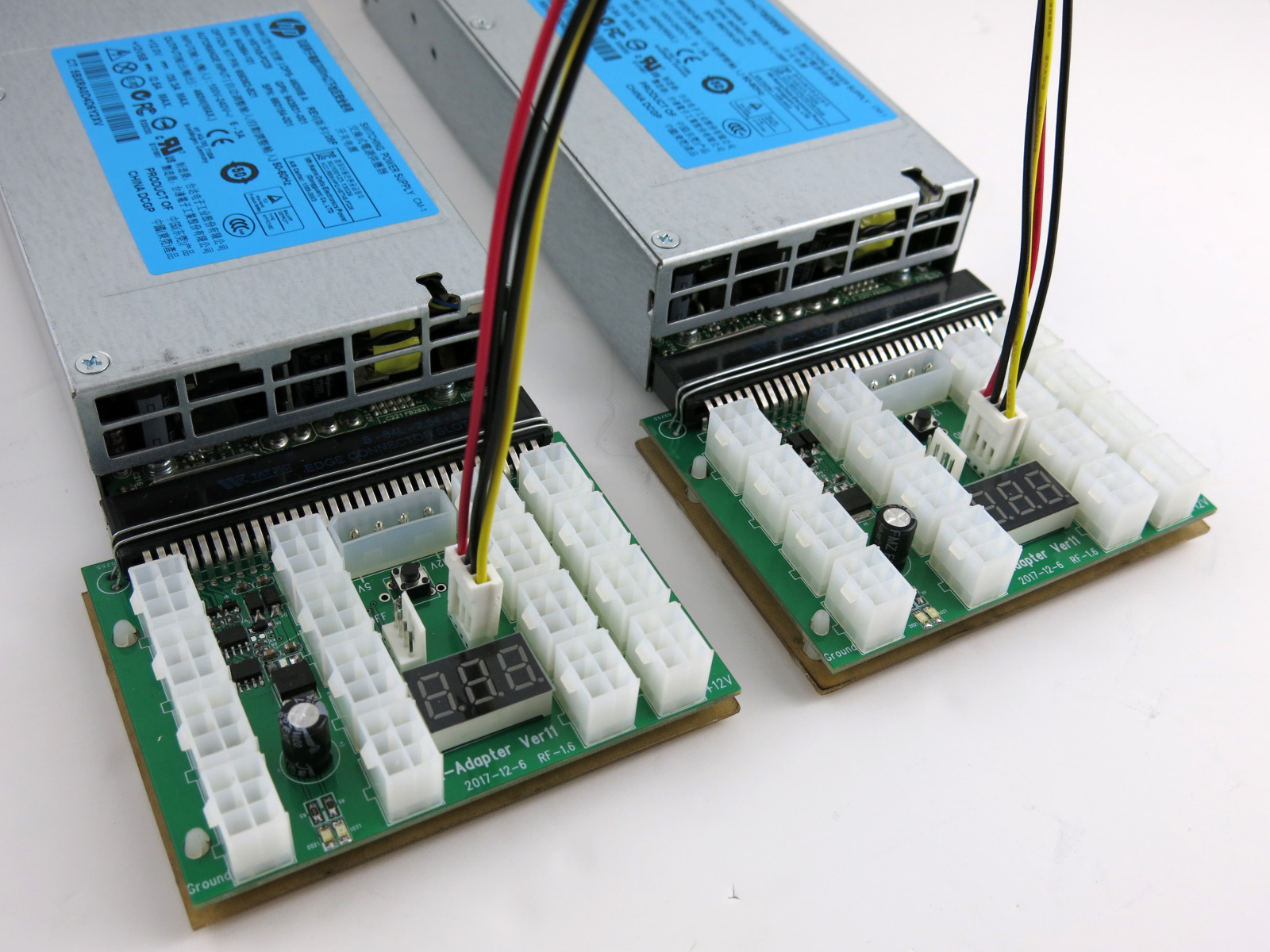 Interconnect sync cable attached to (2) X11 breakout boards to power off and on together