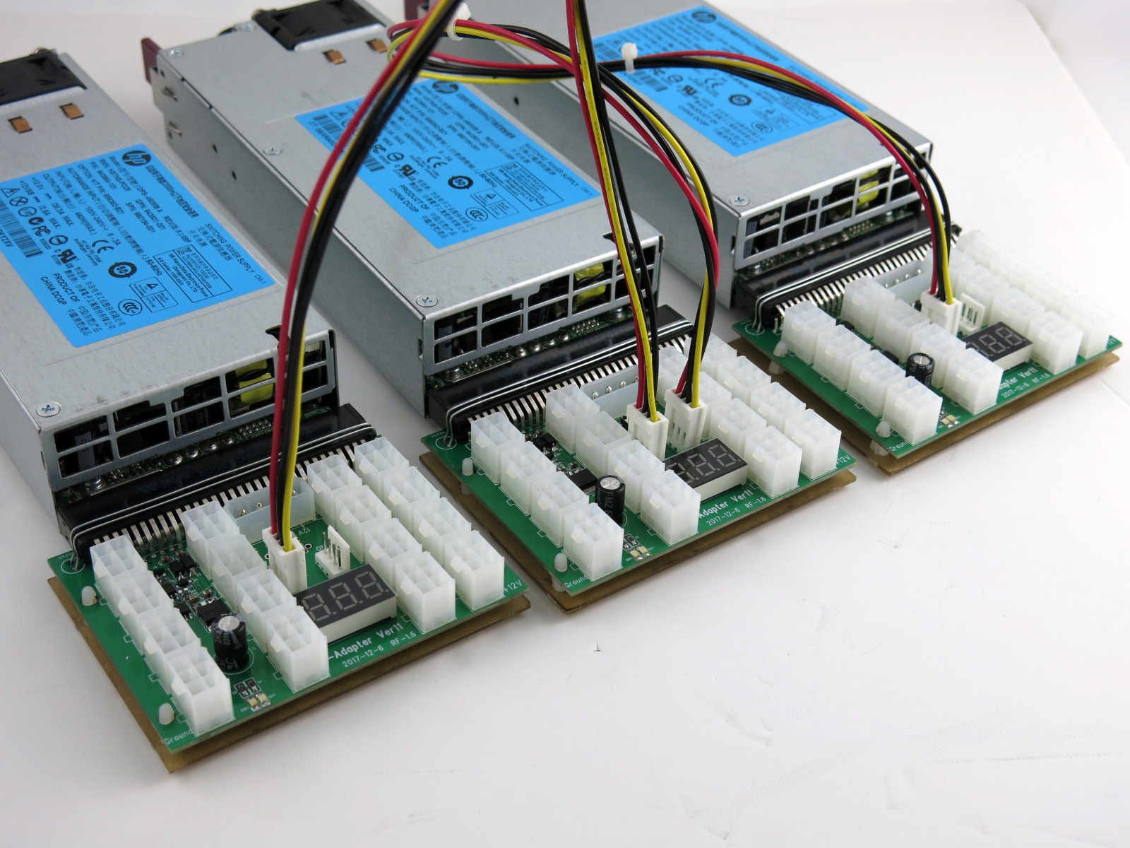 (3) X11 boards connected by interconnect sync cables for mining bitcoin power supply